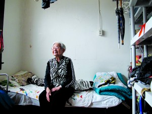 Rosesari in her room at the May Wah hotel, a privately owned single room occupancy hotel in Vancouver's Chinatown. She pays $320 a month. Her neighbours on the same floor pay $200 to $290 a month.