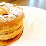 Classic Paris Brest freshly baked in-house. Choux ring with praline cream filling from Bakery Sate.